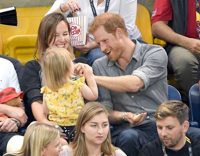 Watch Prince Harry prove he will be the best dad as little girl steals his popcorn