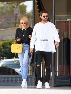 Sofia Richie and Scott Disick celebrate a mystery milestone with cake over the weekend