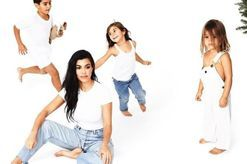 The internet believes the annual Kardashian Christmas card will confirm whether Khloe and Kylie are pregnant