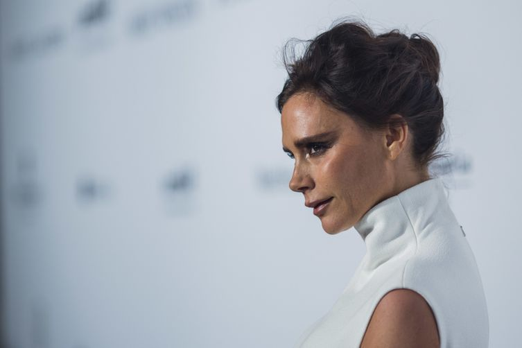 Victoria Beckham receives OBE from Prince William for services to fashion