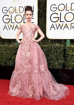 Lily Collins is wearing Zuhair Murad Couture on the Golden Globes 2017 red carpet