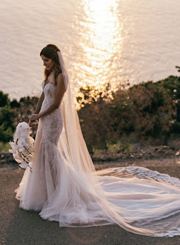 Inside a picture perfect tropical island wedding vogue for Wedding dresses for tropical wedding