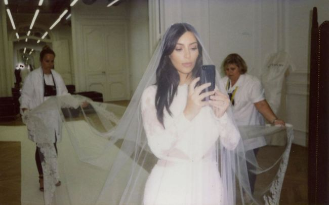 Kim kardashian shares never before seen pictures from her givenchy here kim can be seen snapping a selfie while the givenchy dressmakers measure and fit the gowns train junglespirit Choice Image